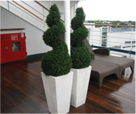 artificial topiary tree in planter