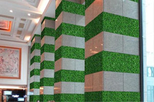 faux hedges for feature wall design
